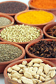 A variety of spices in earthen bowls