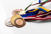variety of sport medals on white