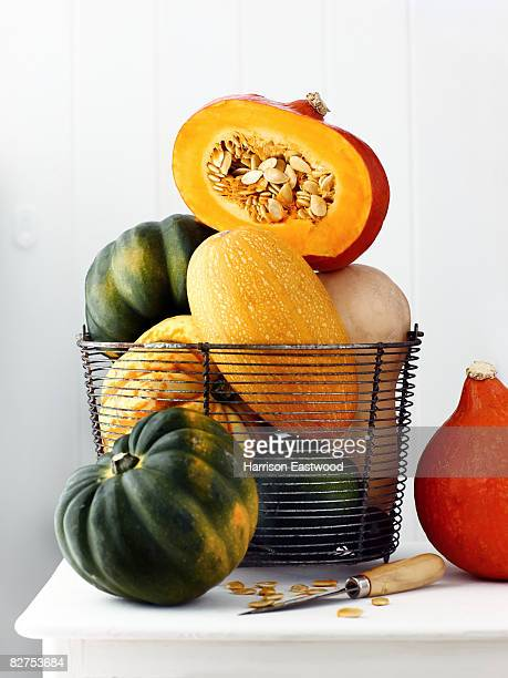 Variety of squashes on sideboard one cut open