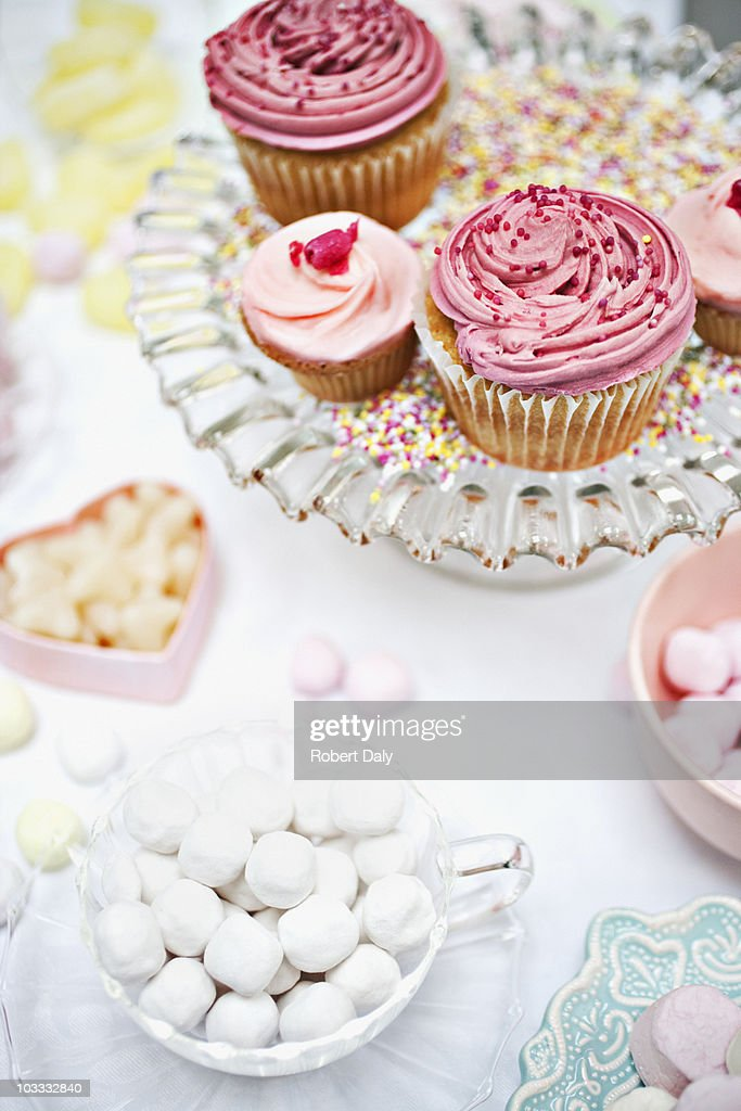 Variety of sweets in dishes on table : Stock Photo