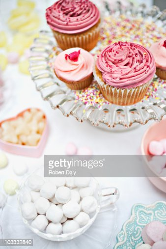Variety of sweets in dishes on table