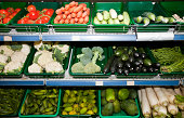 Variety of vegetables on display in supermarket