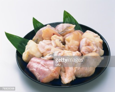Variety types of bony parts on plate, high angle view : Stock Photo