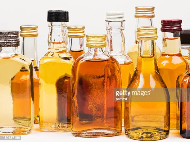 Various alcohol bottles on white