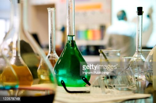 Various beakers in science laboratory. : Stock Photo