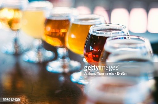 Various Beers In Wineglass On Table