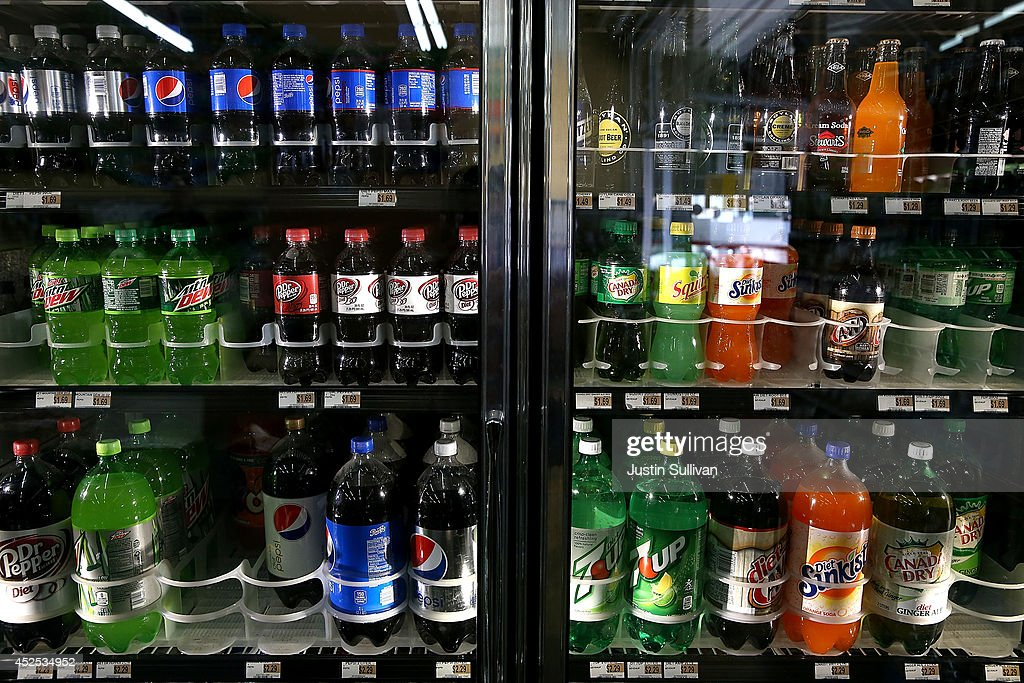 Various bottles of soda are displayed in a cooler at Marina Supermarket on July 22, 2014 in San Francisco, California. The San Francisco Board of Supervisors will vote on Tuesday to place a measure on the November ballot for a 2-cents-per-ounce soda tax. If the measure passes in the November election, tax proceeds would help finance nutrition, health, disease prevention and recreation programs.