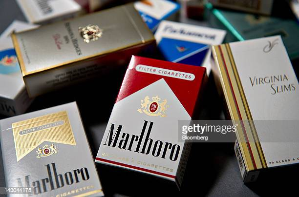 Various brands of Philip Morris International Inc cigarettes packs including Marlboro and Virginia Slims are arranged for a photograph in Tiskilwa...