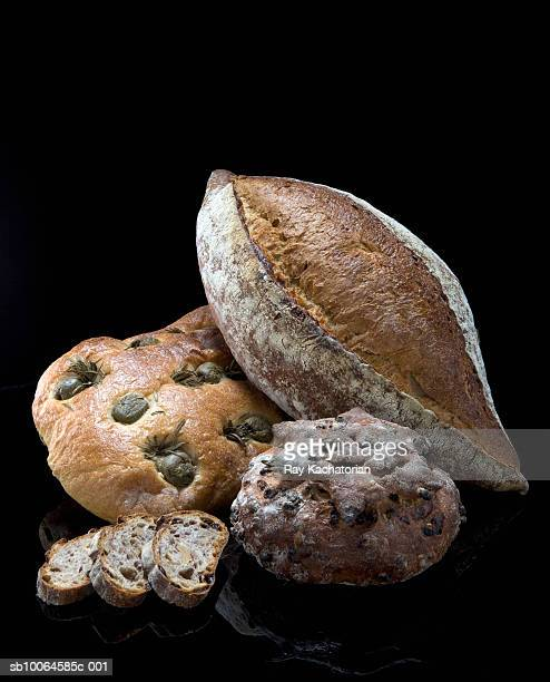 Various breads and rolls, black background