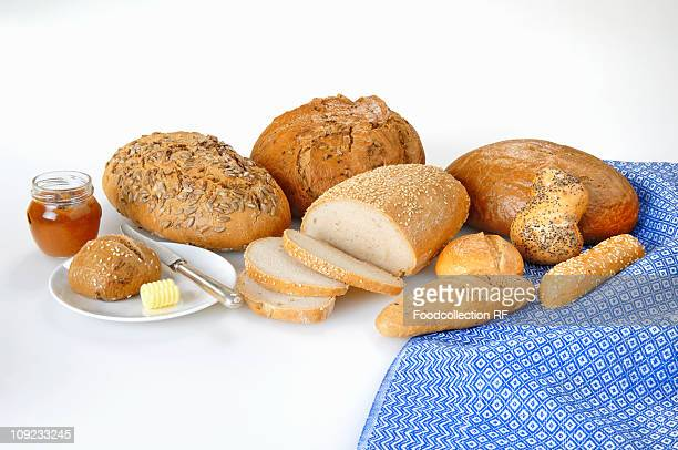 Various breads and rolls on white background, close-up