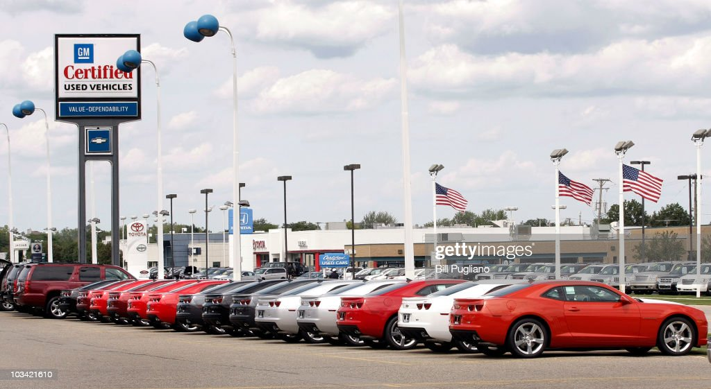 Various cars sit in the lot for sale at a General Motors used car dealership at the Troy Motor Mall August 17 2010 in Troy Michigan GM intends to...