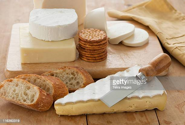 Various cheeses and bread on table