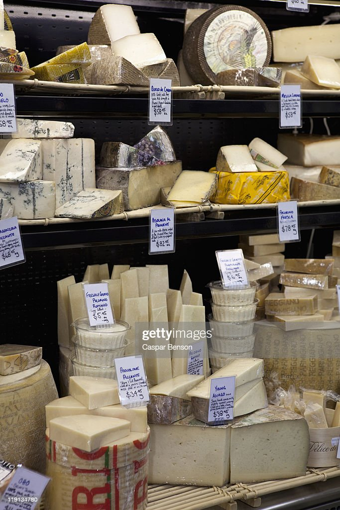 Various cheeses at a market stall