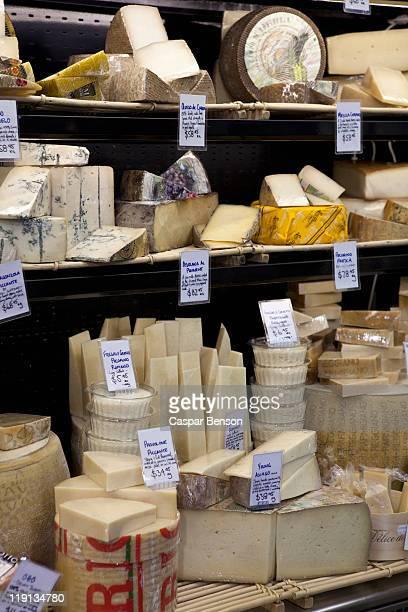 Various cheeses at a market stall