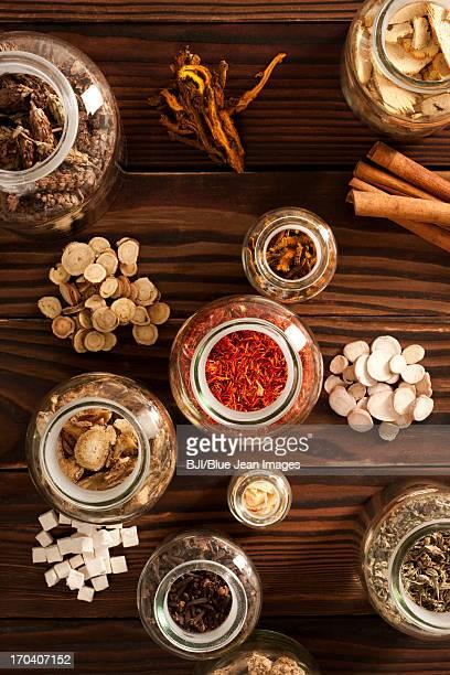 Various Chinese medical herbs in jars