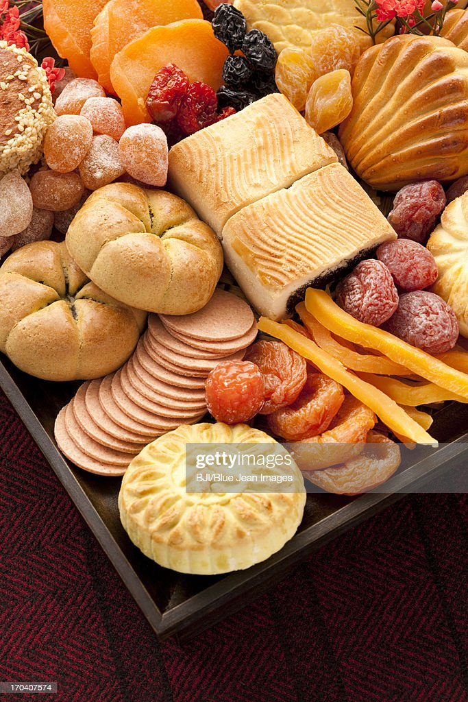 Various Chinese traditional dim sum and preserved fruits : Stock Photo