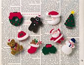 Various Christmas ornaments on newspaper, high angle view