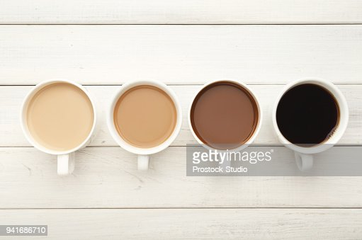 Various coffee cups on white wood, top view : Stock Photo