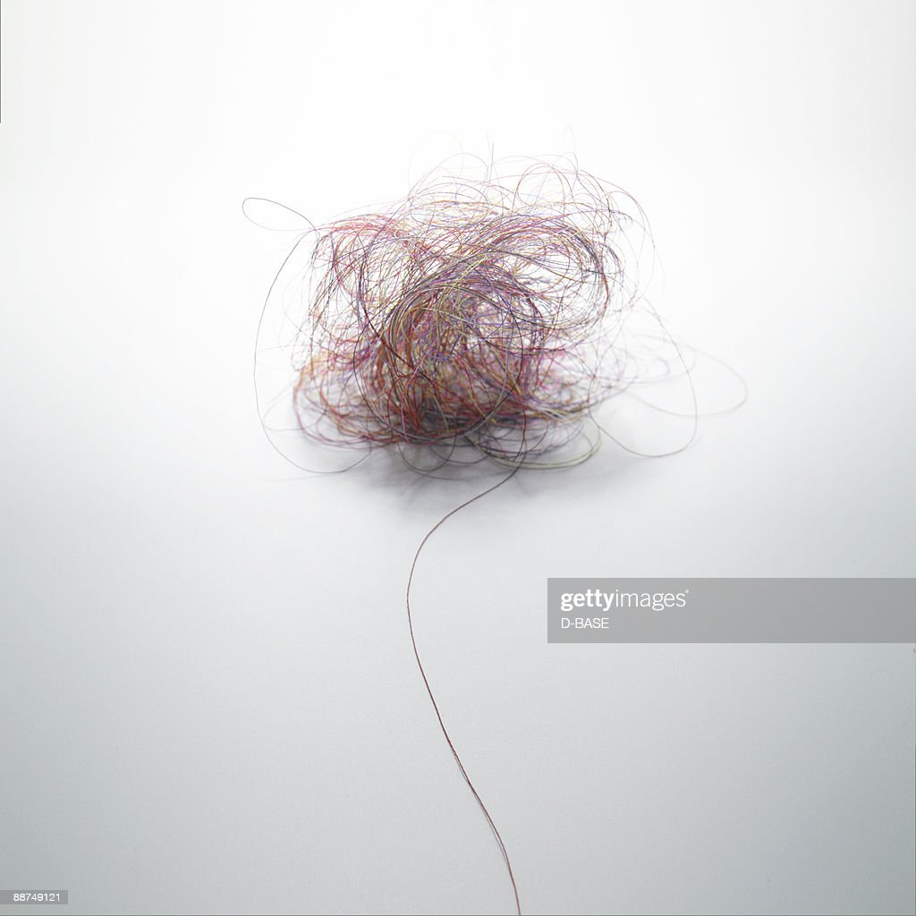 Various colored threads entangled. : Stock Photo
