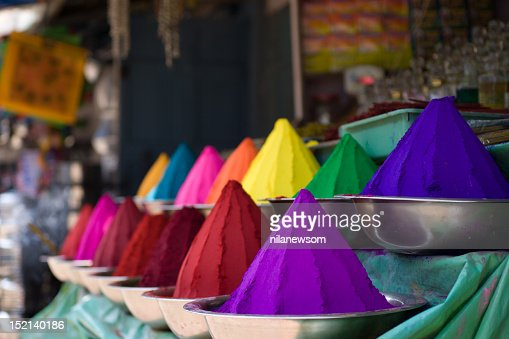 Various colorful mounds of powder in bowls : Stock Photo