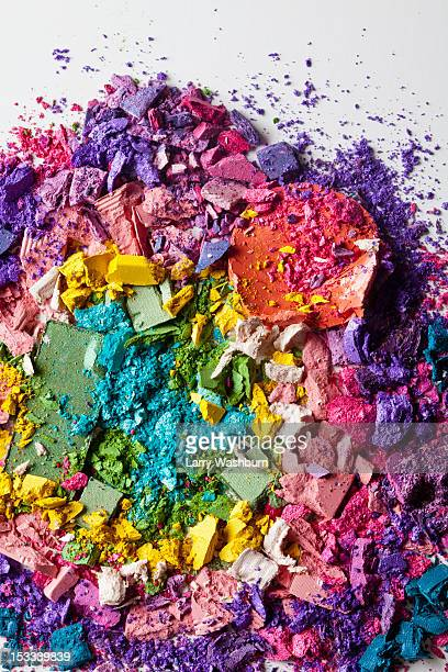 Various crushed up make-up powder products arranged in an abstract pattern