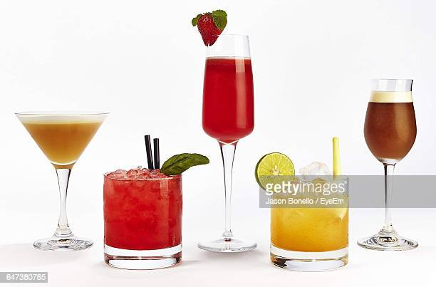 Various Drinks In Glasses Against White Background