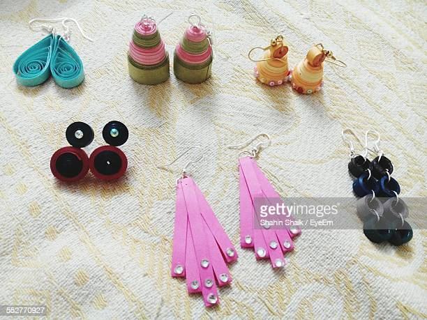 Various Earrings On Cloth
