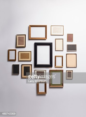 Various empty picture frames hanging on a wall