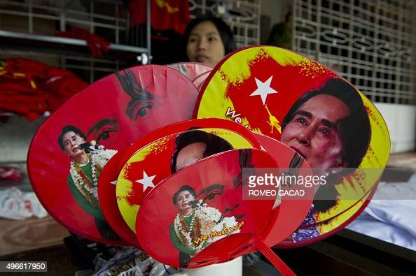 Various fans with portraits of Myanmar opposition leader Aung San Suu Kyi are seen for sale outside the National League for Democracy party...