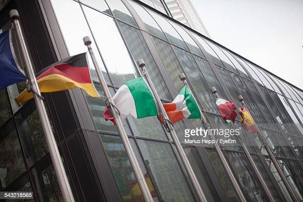 Various Flags Outside Modern Building