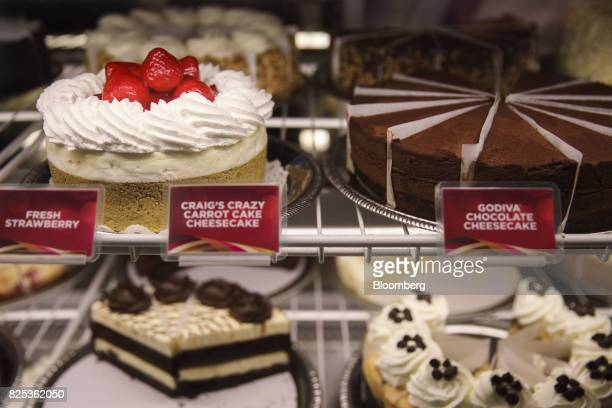 Various flavored cheesecakes sit in a display case at a Cheesecake Factory Inc restaurant in the Canoga Park neighborhood of Los Angeles California...