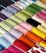 Various folded socks arranged by colour (full frame)