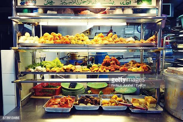 Various Fried Food Arranged On Shelf At Food Stall