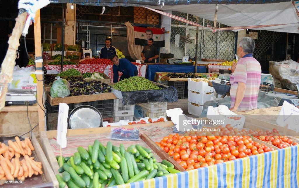 Various fruits and fishes are arranged at stalls on May 1, 2014 in Latakia, Syria.