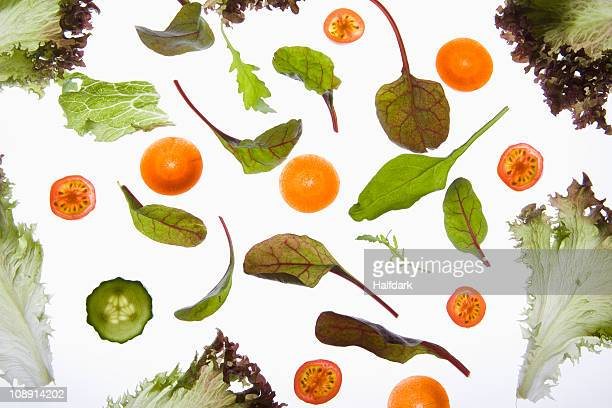 Various fruits and vegetables arranged on a lightbox