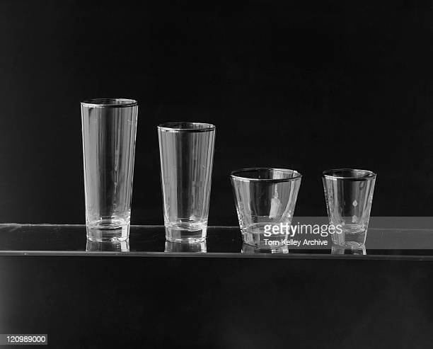Various glasses against black background, close-up