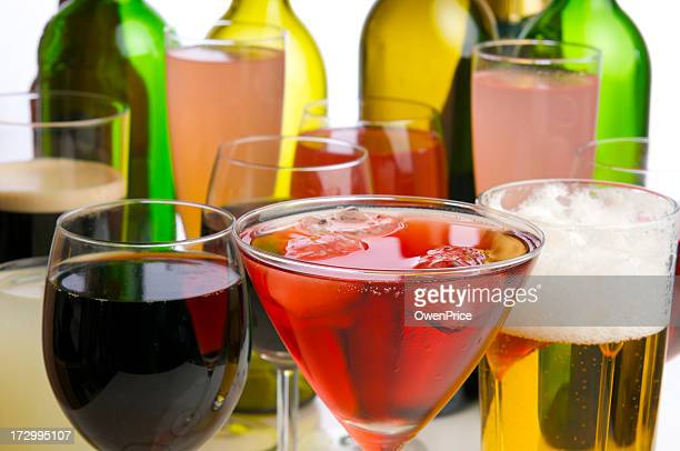 Various glasses filled with colorful drinks