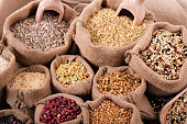 Various grains and cereals in sack on market stall