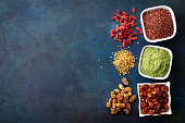 Various superfoods on old blue background. Top view