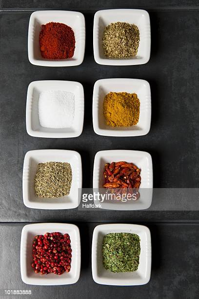 Various herbs and spices in small bowls