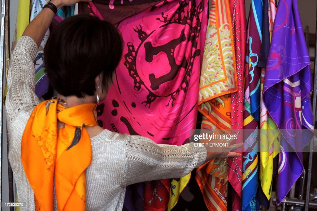 Various Hermes silk scarves are presented at a presentation at the Nissim de Camondo Museum in Paris on July 4 2013 of textile crafts at French...