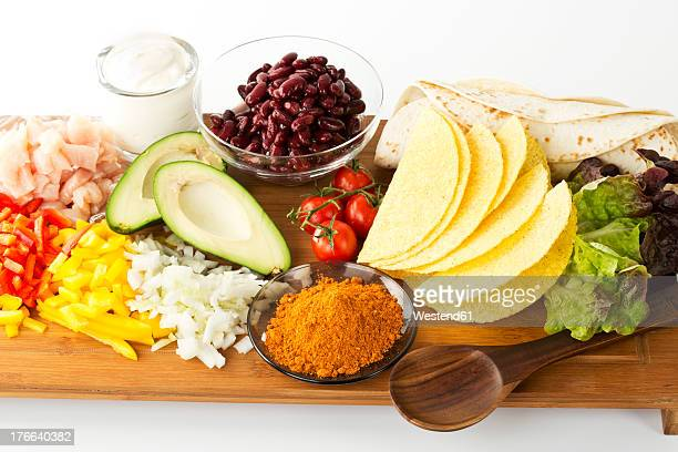 Various ingredients for fajitas and tacos on chopping board