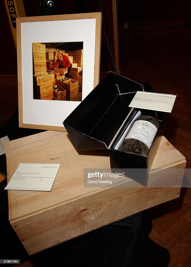 Various items for sale which include a 174 year old bottle of Brandy (pictured) at the charity auction of Roald Dahl's private photographs at Christie's auction house on December 13, 2004 in London. The photographs have been developed especially for the event by Roald's 18 year-old grandson Luke Kelly.