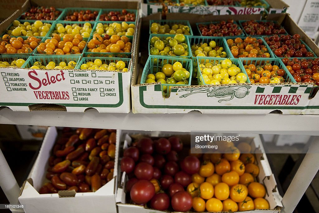 Various kinds of tomatoes sit in crates at the Specialty Produce warehouse in San Diego, California, U.S., on Friday, Nov. 1, 2013. The U.S. Bureau of Economic Analysis is scheduled to release gross domestic product (GDP) figures on Nov. 7. Photographer: Sam Hodgson/Bloomberg via Getty Images
