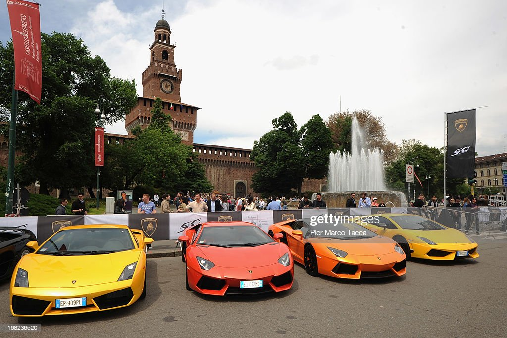 Various Lamborghinis sit parked in Castle Square on May 7, 2013 in Milan, Italy. Automobili Lamborghini S.p.A is celebrating its 50th Anniversary (1963-2013) with a program of initiatives, culminating with the Lamborghini Anniversary Grand Tour across Italy with over 350 Lamborghinis participating that will arrive in Bologna.
