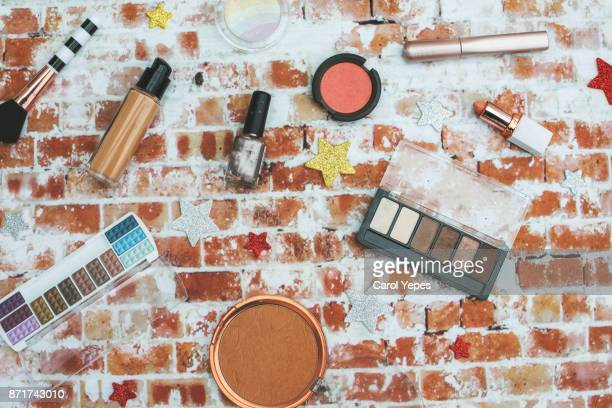 various makeup products and cosmetics in rustic background.Top view