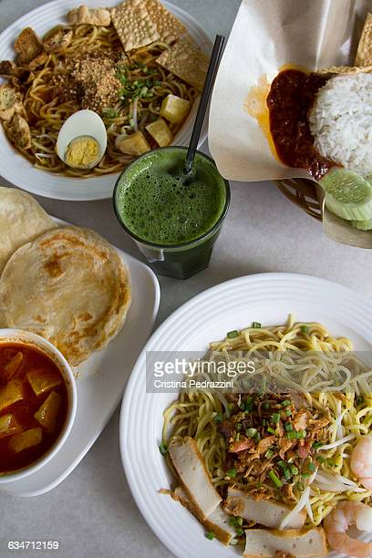 Various Malaysian food dishes and juice drink
