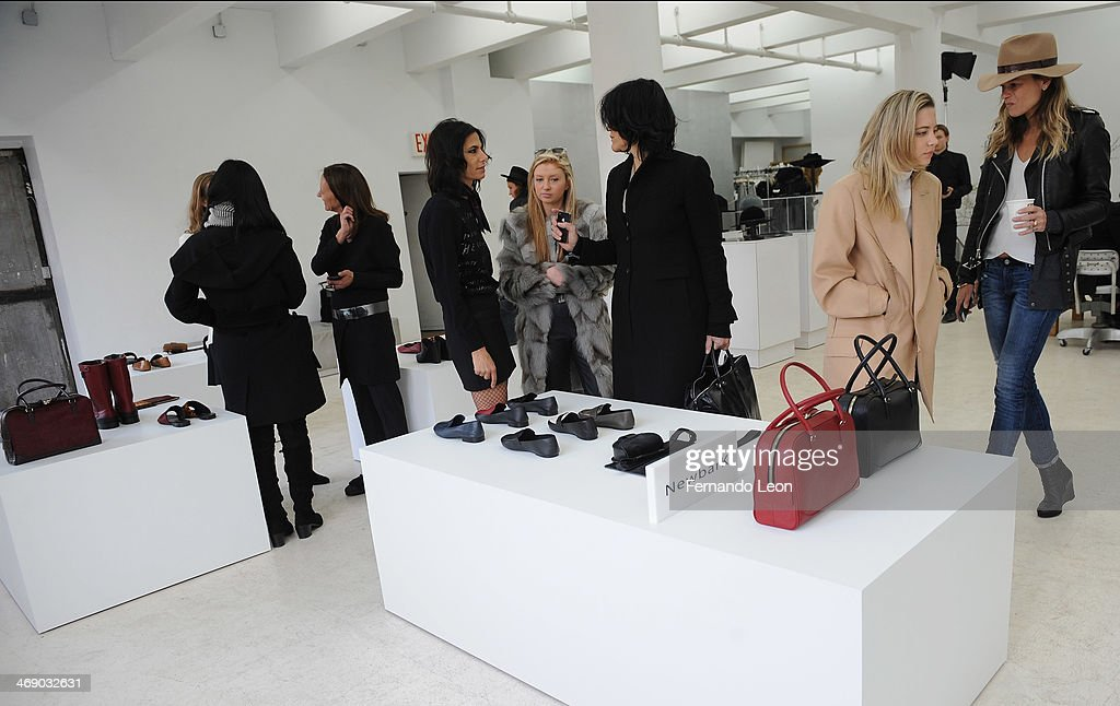 Various members of the press gather around some of the new items featured during the Newbark presentation during Mercedes-Benz Fashion Week Fall 2014 on February 12, 2014 in New York City.