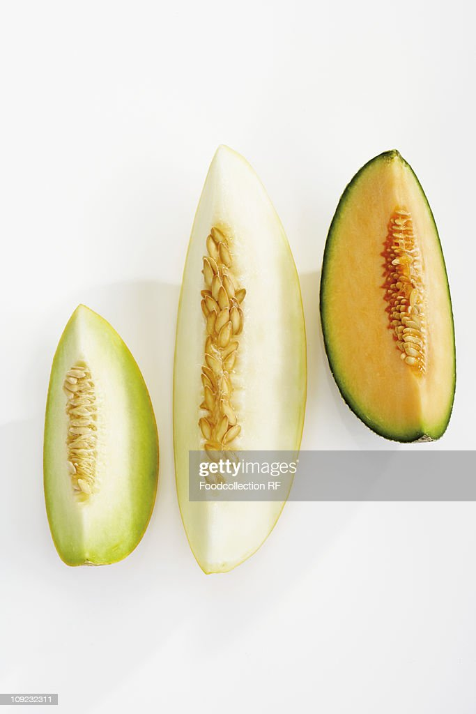 Various muskmelon slices on white background, close-up