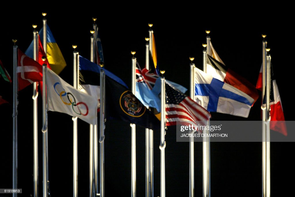 Various national flags fly 08 February 2002 during the opening ceremonies of the 2002 Winter Olympics at the Rice Eccles Stadium in Salt Lake City...